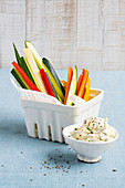 Raw vegetable sticks with a hummus quark dip
