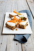 Carrot cake slices with cream cheese frosting