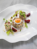 Vegetable and quinoa tatar with a fried quail's egg