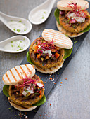 Mini veggie burgers with lime yoghurt and salad
