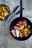 Oven-roasted duck breast with rosemary potatoes