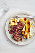 Beef minute steaks with glazed parsnips