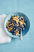 Quinoa breakfast with almond drink, blueberries and hazelnuts