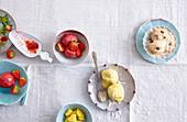 Strawberry and cashew ice cream, peanut ice cream with rum raisins, and pineapple and coconut ice cream