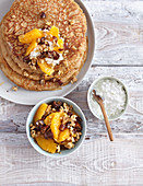 Spelt pancakes with oranges and nuts