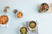 Carrot and apple salad, bean salad and quinoa tabbouleh with mint