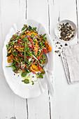 Quinoa salad with vegetables, pumpkin seeds and mint