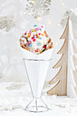 A bubble waffle with frozen yogurt and colourful chocolate sweets for Christmas