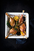 Goose legs with orange and thyme