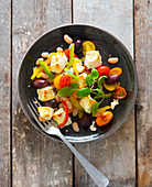 Sheep's cheese salad with tomatoes, olives and pepper