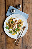 Turkey escalope with roasted mango noodles