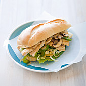 Chicken submarine sandwich with onions, mushrooms and bellpepper
