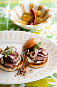 Beef tenderloin sliders with onions and arugula