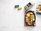 Ofenlachs mit Blumenkohl und Sauce Hollandaise überbacken