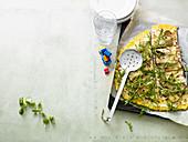 Polenta tarte flambée with mushrooms, rocket and ham