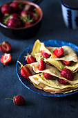 Crepes with strawberries and vanilla cream