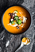 Pumpkin soup with brussels sprouts and goat's cheese