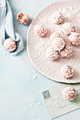 Coconut and oat balls with raspberries