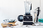 A high-performance blender, a citrus press, a fine sieve and an ice cube container