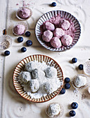 Blueberry truffles with cinnamon liqueur in icing sugar