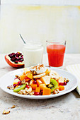 Colourful fruit salad with cinnamon yoghurt