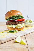 A homemade burger with beef and guacamole