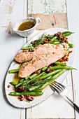 Braised salmon with beans and nectarines on baking paper