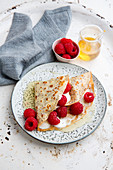 Poppyseed crepes with a raspberry and quark filling