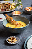 Coconut and mango soup with chicken
