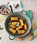 Homemade fish fingers with a beetroot and apple salad