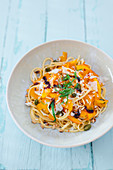 Linguini with pumpkin, pistachio nuts, pine nuts and Pecorino cheese