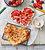 Puff pastry hearts with strawberries and cream