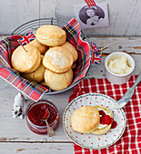 Scones with clotted cream and raspberry jam