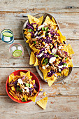 Pulled pork, cabbage and caramelised pineapple nachos