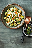 Potato, soft-boiled egg and mixed herb salad