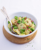 Broad bean and potato salad with diced bacon