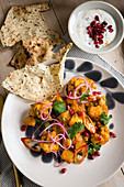 Cauliflower curry with pomegranate raita and papadums