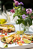 Tacos with seabass tempura and peach salsa