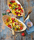 Mango and strawberry salad with almonds for lunch