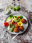 Falafel on a colourful summer salad