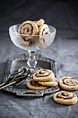 Marzipan biscuits with nougat swirls and icing (vegan)