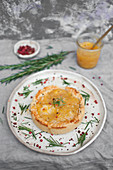 Christmas duck shortcrust pie topped with orange-rosemary jam and rose pepper