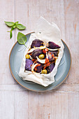 Oven-baked purple potato package with olives