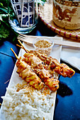 Satay skewers with peanut sauce (street food)