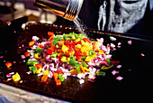 Street Food - finely chopped vegetables on a grill platter