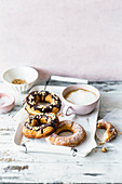 Cronuts with icing sugar and chocolate