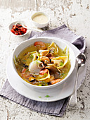 Seafood in an artichoke broth with tortellini and aioli