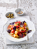 Tomato and watermelon salad with red basil and green olives
