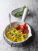 Vegan tofu and herb scramble with tomatoes