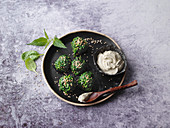 Vegan stinging nettle balls with a moringa and soya dip